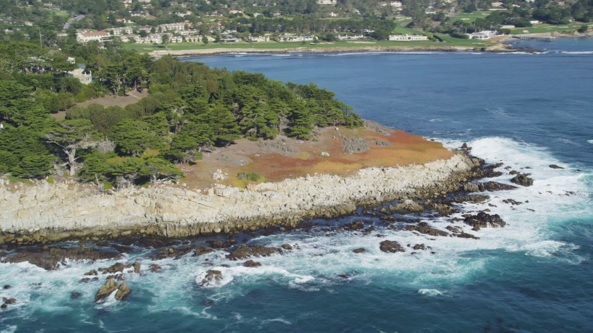 5K stock footage aerial video of flying by the rugged coastline, Pebble Beach, California Aerial Stock Footage | DFKSF16_027
