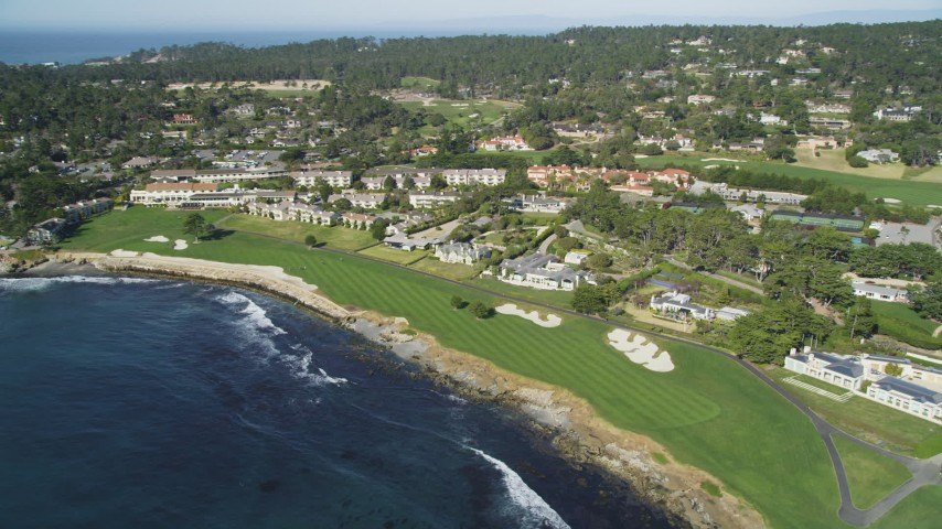 5K stock footage aerial video flyby Pebble Beach Resorts hotel and Pebble Beach Golf Links, Pebble Beach, California Aerial Stock Footage | DFKSF16_028