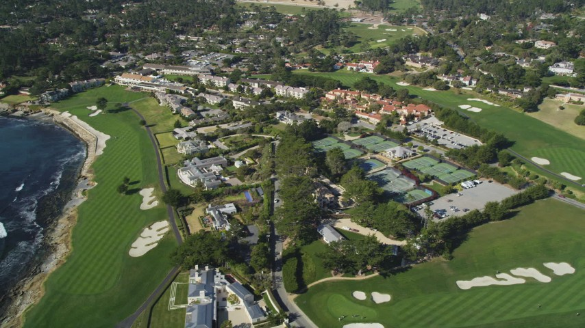 5K stock footage aerial video of Pebble Beach Resorts hotel, tennis courts, and Pebble Beach Golf Links, Pebble Beach, California Aerial Stock Footage | DFKSF16_030