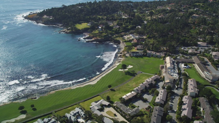 5K stock footage aerial video of a resort hotel and golf course on the shore of Carmel Bay in Pebble Beach, California Aerial Stock Footage | DFKSF16_031