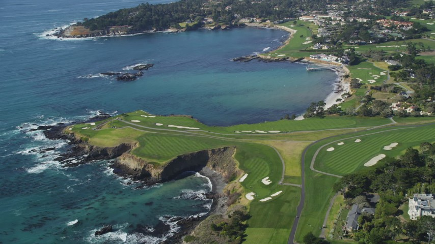 5K stock footage aerial video of a waterfront golf course by Carmel Bay, Pebble Beach, California Aerial Stock Footage | DFKSF16_036