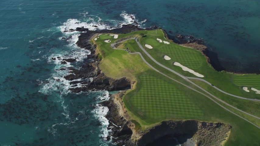 5K stock footage aerial video of flying over Pebble Beach Golf Links golf course and Carmel Bay, Pebble Beach, California Aerial Stock Footage | DFKSF16_037
