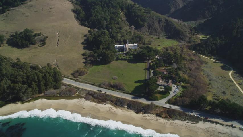 5K stock footage aerial video pan from beach to reveal Carmel Monastery, Carmel, California Aerial Stock Footage | DFKSF16_040