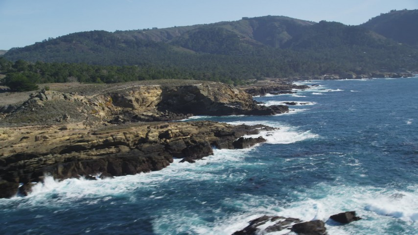 5K stock footage aerial video of passing coastal cliffs in Carmel, California Aerial Stock Footage | DFKSF16_046