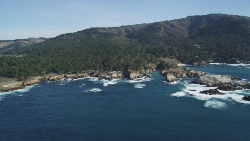 5K stock footage aerial video of flying by rugged coastline with trees and rock formations, Carmel, California Aerial Stock Footage | DFKSF16_047
