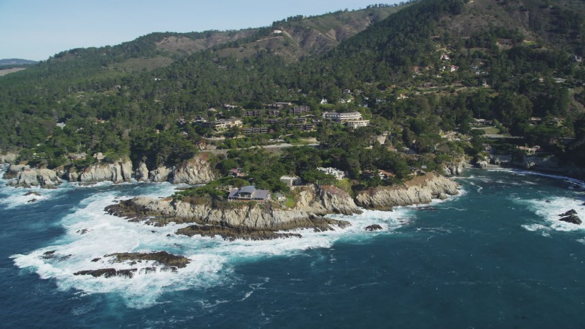 5K stock footage aerial video of flying away from oceanfront mansions in Carmel, California Aerial Stock Footage | DFKSF16_049
