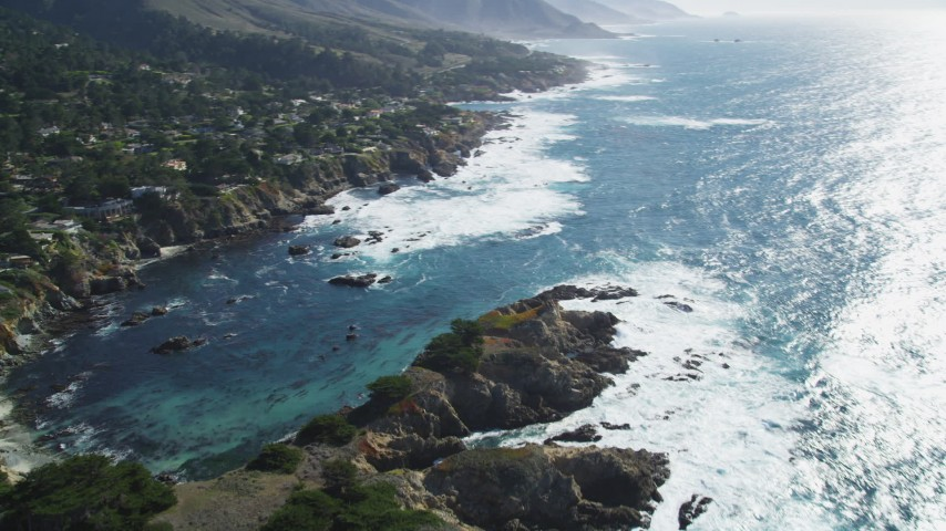 5K stock footage aerial video of panning to oceanfront homes and a cove on the coast, Carmel, California Aerial Stock Footage | DFKSF16_050