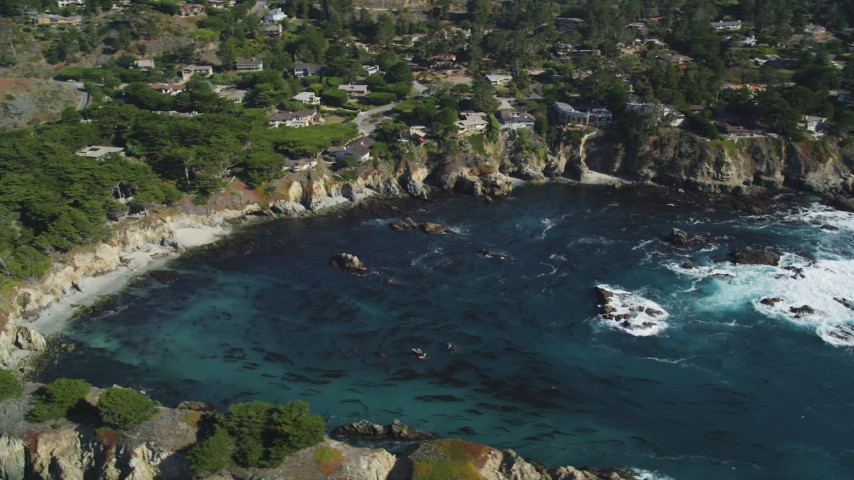 5K stock footage aerial video of flying by oceanfront homes and a cove, Carmel, California Aerial Stock Footage | DFKSF16_051