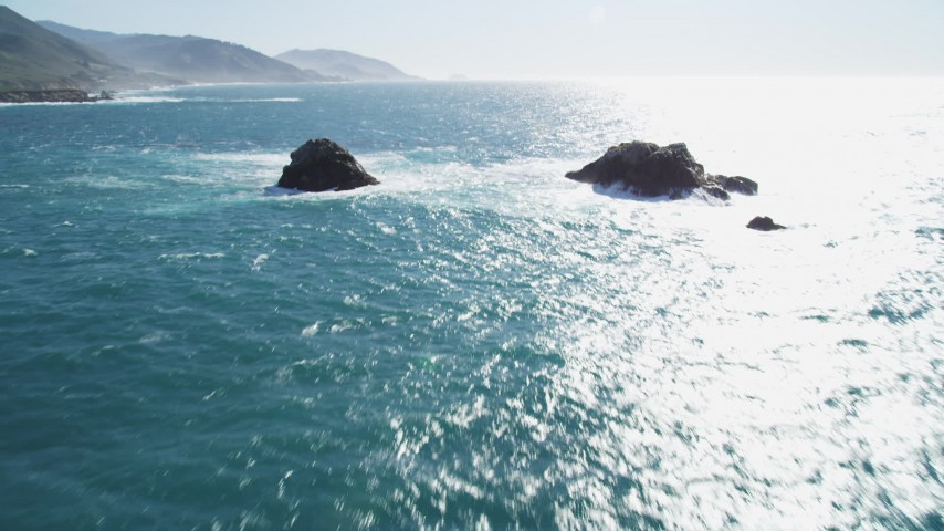 5K stock footage aerial video of tilting from the ocean to reveal coastal rock formations, Carmel, California Aerial Stock Footage | DFKSF16_052