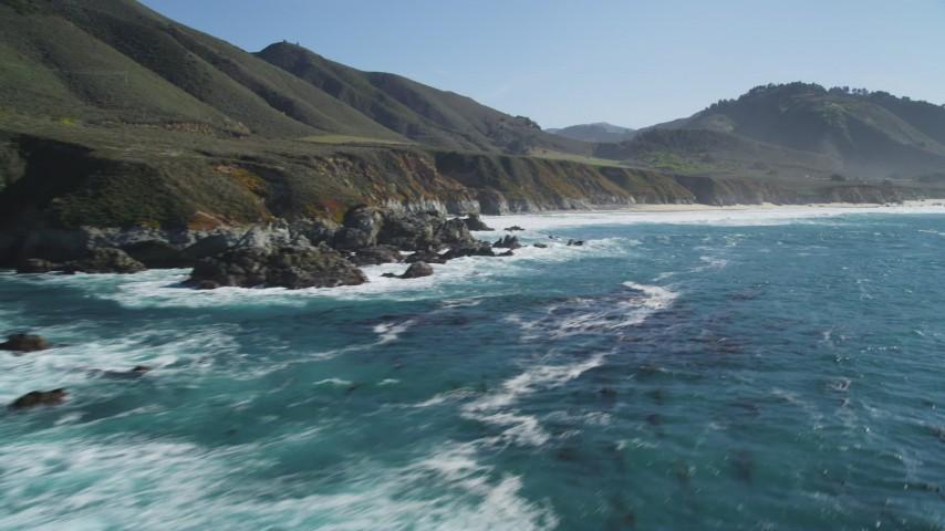 5K stock footage aerial video pan across coastal rock formations and beach, Carmel, California Aerial Stock Footage | DFKSF16_061