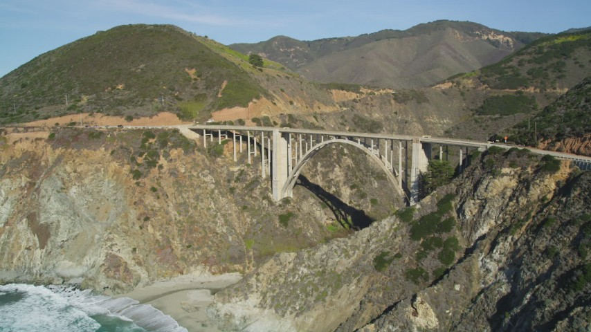 5K aerial video of approaching the Bixby Creek Bridge above coastal cliffs, Big Sur, California Aerial Stock Footage | DFKSF16_073