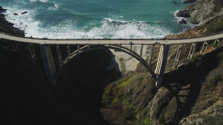 5K stock footage aerial video of orbiting Bixby Creek Bridge above coastal cliffs, Big Sur, California Aerial Stock Footage | DFKSF16_074