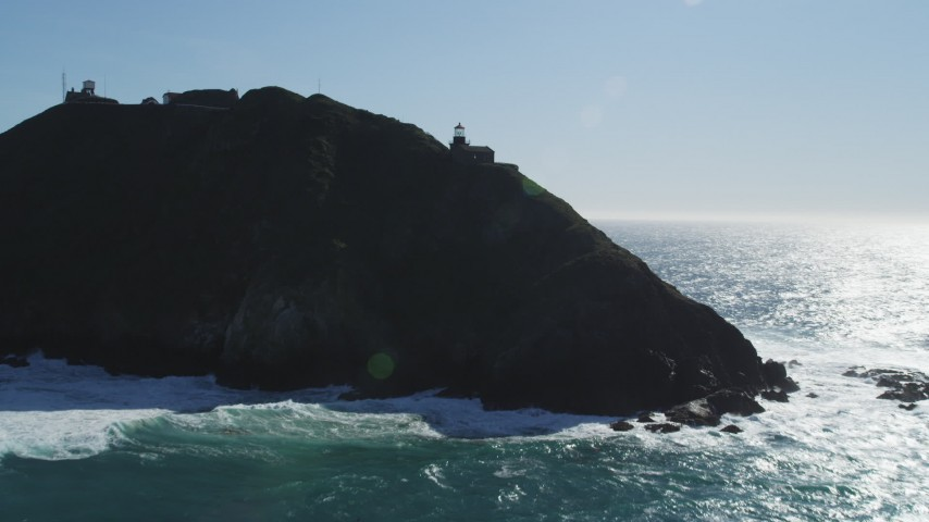 5K stock footage aerial video tilt from ocean revealing Point Sur Light Station, Big Sur, California Aerial Stock Footage | DFKSF16_089