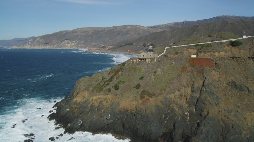 5K aerial video of flying by the Point Sur Light Station on coastal cliffs, Big Sur, California Aerial Stock Footage | DFKSF16_090