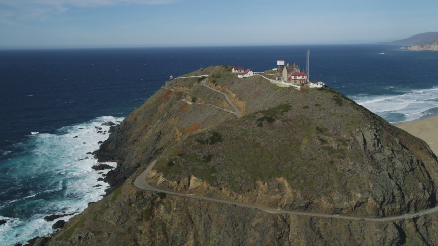 5K aerial video of flying around back of Point Sur Light Station, above the coastline, Big Sur, California Aerial Stock Footage | DFKSF16_091