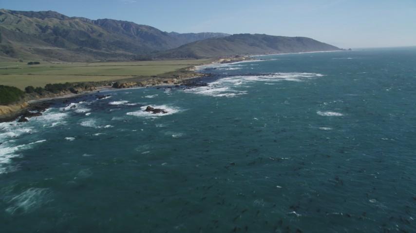 5K aerial video tilt from ocean to reveal coastline, Big Sur, California Aerial Stock Footage | DFKSF16_094