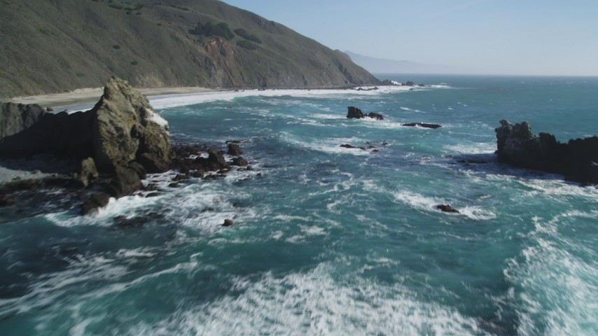 5K stock footage aerial video of flying low over coastal rock formations near cliffs, Big Sur, California Aerial Stock Footage DFKSF16_102 | Axiom Images