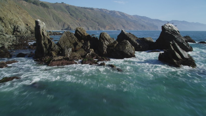 5K stock footage aerial video tilt from ocean to reveal rock formation near coastal cliffs, Big Sur, California Aerial Stock Footage | DFKSF16_106