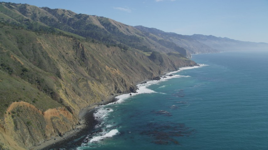 5K aerial video of panning across coastal cliffs and a beach, Big Sur, California Aerial Stock Footage | DFKSF16_109