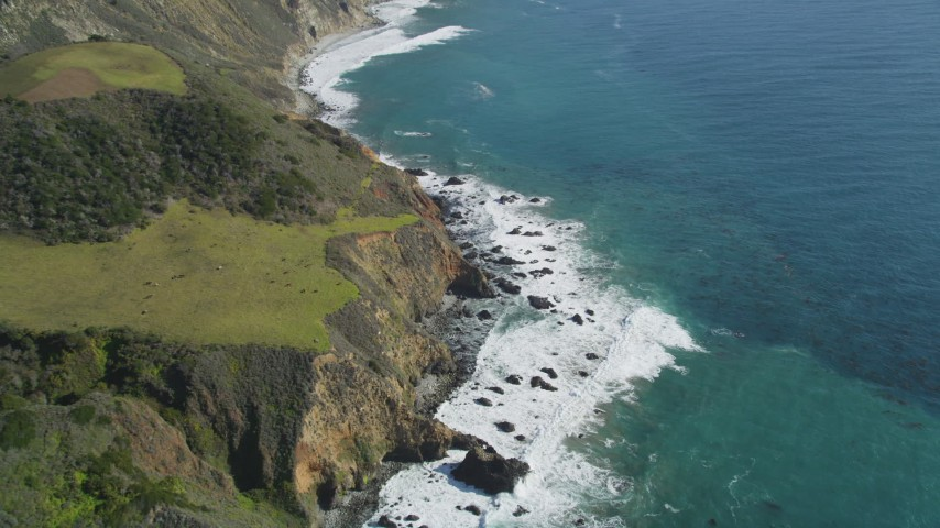 5K stock footage aerial video approach and tilt to waves and coastal cliffs, Big Sur, California Aerial Stock Footage | DFKSF16_111