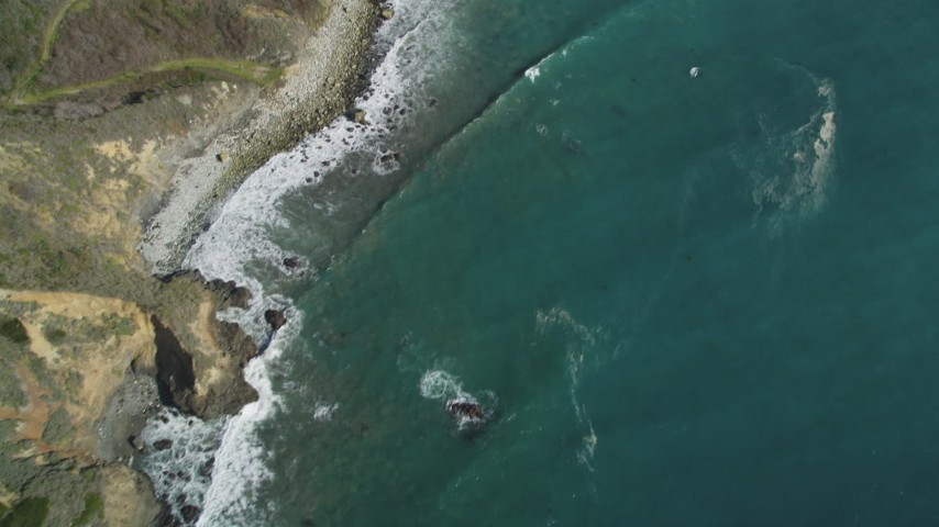5K aerial video of a bird's eye view of coastal cliffs, revealing rocky beach, Big Sur, California Aerial Stock Footage | DFKSF16_112