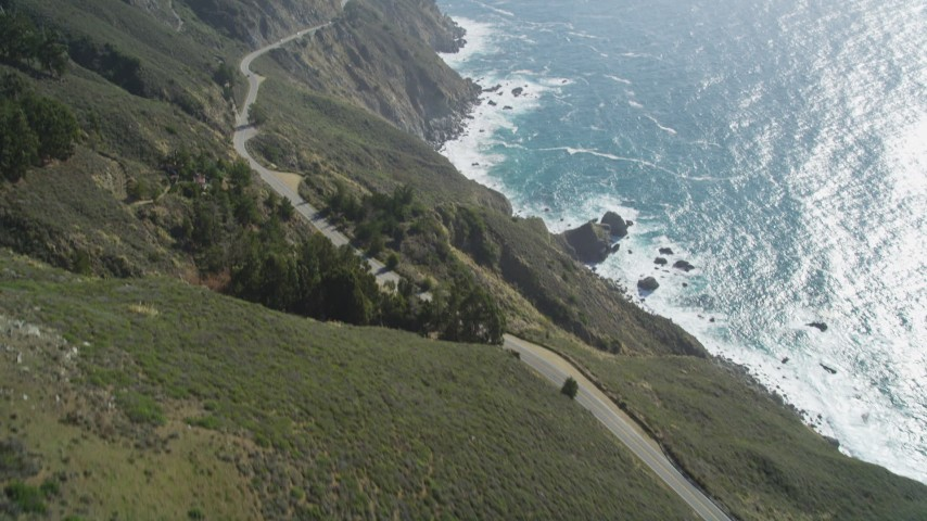 5K stock footage aerial video fly over Highway 1 winding atop cliffs, tilt to reveal ocean views, Big Sur, California Aerial Stock Footage | DFKSF16_117