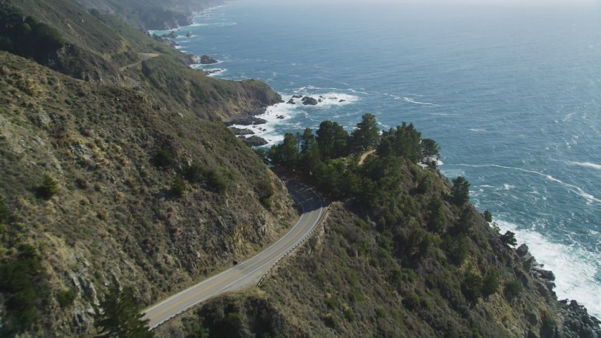 5K aerial video of following Highway 1 atop coastal cliffs, Big Sur, California Aerial Stock Footage | DFKSF16_119