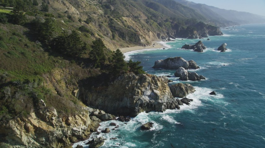 5K aerial video of flying over rock formations and coastal cliffs, Big Sur, California Aerial Stock Footage DFKSF16_120