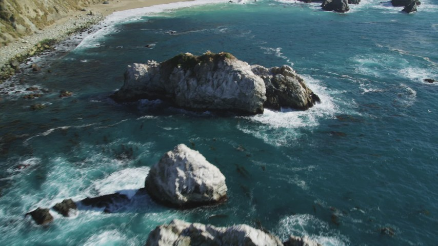 5K aerial video of flying over large coastal rock formations in the ocean, Big Sur, California Aerial Stock Footage | DFKSF16_121