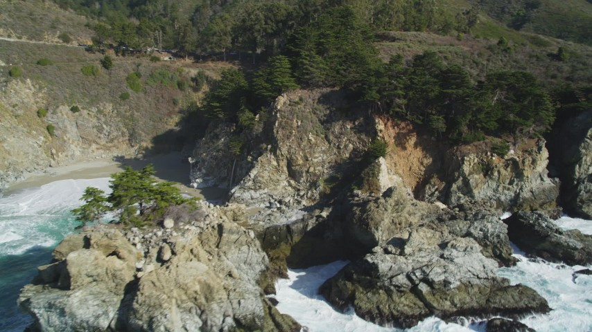 5K stock footage aerial video of tilting from the ocean to reveal McWay Falls, Big Sur, California Aerial Stock Footage | DFKSF16_123