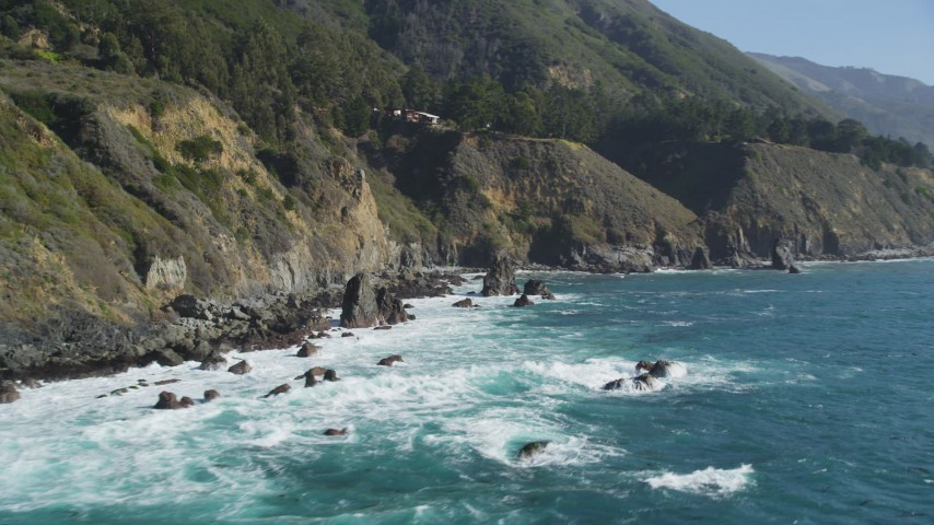 5K stock footage aerial video of flying by rock formations atop steep coastal cliffs, Big Sur, California Aerial Stock Footage | DFKSF16_126