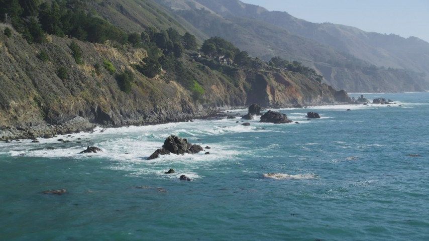5K aerial video of flying low by steep coastal cliffs and rock formations, Big Sur, California Aerial Stock Footage | DFKSF16_127