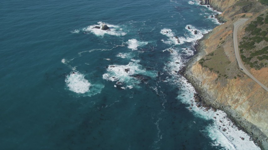 5K aerial video of flying away from Highway 1 and coastal cliffs, Big Sur, California Aerial Stock Footage | DFKSF16_128