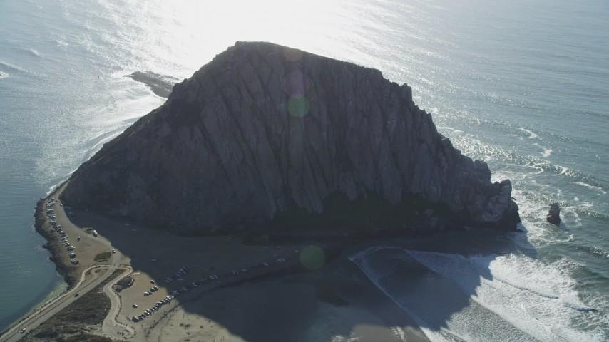 5K stock footage aerial video of flying by Morro Rock overlooking the ocean in Morro Bay, California Aerial Stock Footage | DFKSF16_155