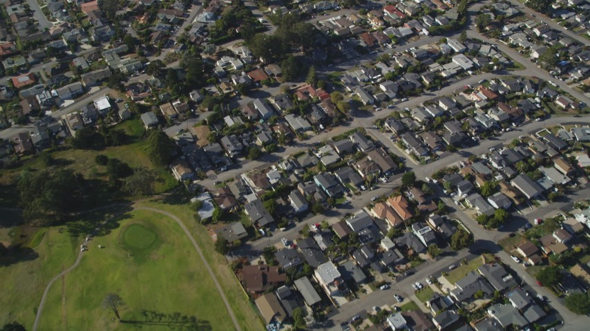 5K stock footage aerial video of a reverse view of suburban homes, reveal Morro Bay Golf Course, California Aerial Stock Footage | DFKSF16_158