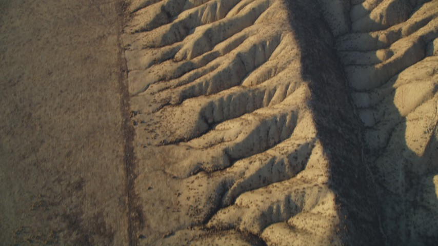 5K aerial video tilt from bird's eye of the San Andreas Fault to wider view of desert in San Luis Obispo County, California Aerial Stock Footage | DFKSF17_028