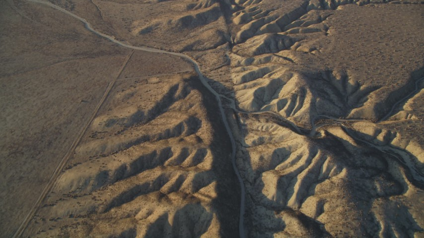 5K stock footage aerial video tilt up along San Andreas Fault in the desert, San Luis Obispo County, California Aerial Stock Footage | DFKSF17_031