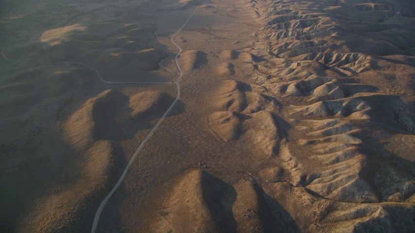5K aerial video of a reverse view of a road beside the San Andreas Fault, San Luis Obispo County, California Aerial Stock Footage | DFKSF17_041