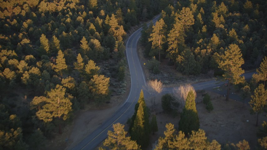 5K stock footage aerial video of following a road through forest, Los Padres National Forest, California, sunset Aerial Stock Footage | DFKSF17_045