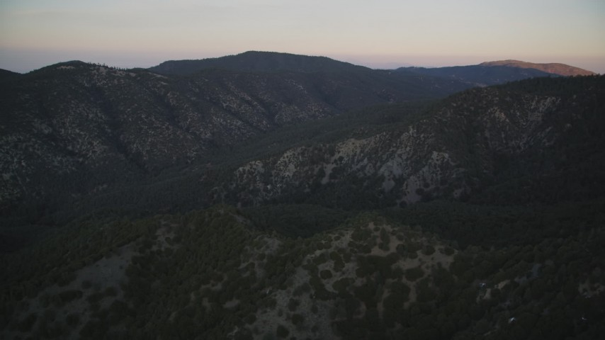5K stock footage aerial video of flying by mountain ridges, Los Padres National Forest, California, twilight Aerial Stock Footage | DFKSF17_048