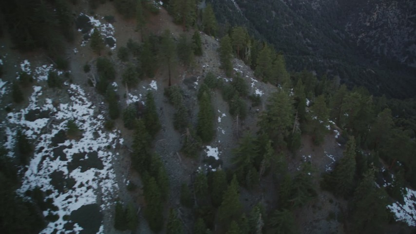 5K stock footage aerial video flyby patches of snow in the mountains, Los Padres National Forest, California, twilight Aerial Stock Footage | DFKSF17_049