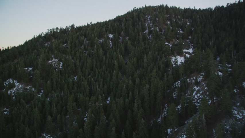 5K stock footage aerial video fly over patches of snow and forest in the mountains, Los Padres National Forest, California, sunset Aerial Stock Footage   DFKSF17_050