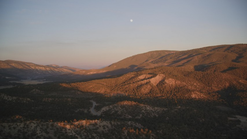 5K stock footage aerial video of flying by mountains with moon above, Los Padres National Forest, California, sunset Aerial Stock Footage | DFKSF17_054