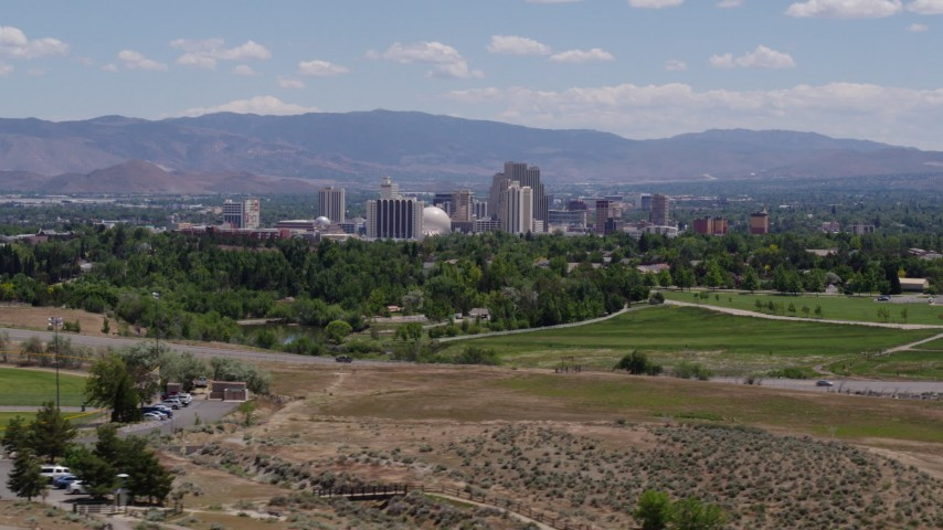 5.7K stock footage aerial video of a view of the city skyline from a park and freeway in Reno, Nevada Aerial Stock Footage   DX0001_000005