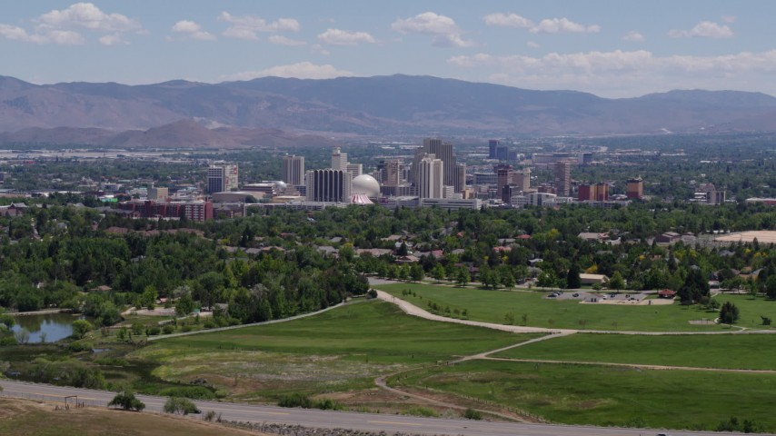 5.7K stock footage aerial video of a view of the distant city skyline, seen from a park in Reno, Nevada Aerial Stock Footage   DX0001_000007