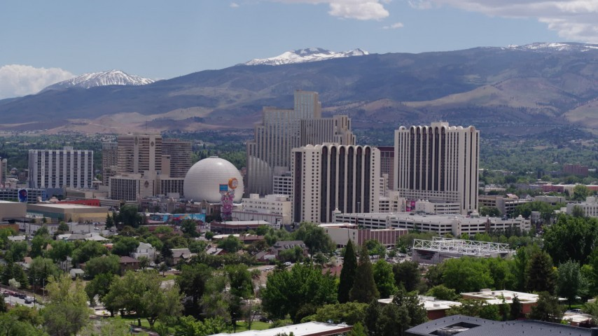 5.7K stock footage aerial video of a view of hotels and casinos with mountains in the distance in Reno, Nevada Aerial Stock Footage | DX0001_000010