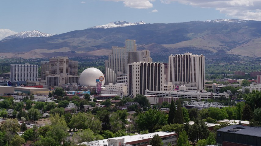 5.7K stock footage aerial video of resort hotels and casinos with mountains in the distance in Reno, Nevada Aerial Stock Footage | DX0001_000011
