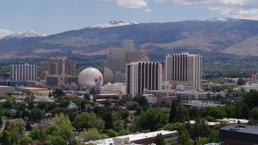 5.7K stock footage aerial video of resort hotels and casinos with mountains in the distance in Reno, Nevada Aerial Stock Footage   DX0001_000012