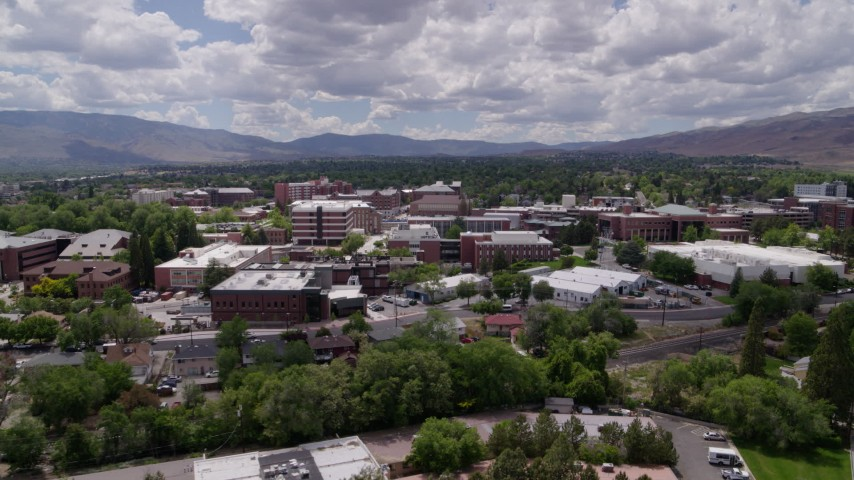 5.7K stock footage aerial video of passing campus buildings at the University of Nevada in Reno, Nevada Aerial Stock Footage | DX0001_000014