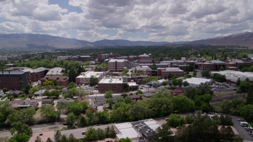 5.7K stock footage aerial video a reverse view of buildings on the campus of the University of Nevada in Reno, Nevada Aerial Stock Footage DX0001_000017 | Axiom Images